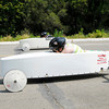 Don Knight/The Herald Bulletin<br /> Taylor Gillum, 12, in the near lane races Tyler Etherington, 7, during the Anderson Soap Box Derby competition at Derby Downs on Saturday.