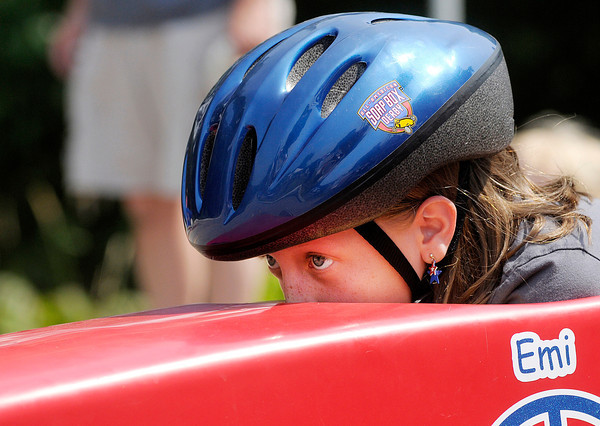 Don Knight/The Herald Bulletin<br /> Emi Isom, 9, concentrates on her line down the track at Derby Downs during the Anderson Soap Box Derby on Saturday.