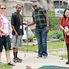 From left, Rev. Tammie Tregellas, Rev. Emmanuel Masamba, Edrin Serwano and Rev. Shelly Win play miniature golf at the Anderson Putt-Putt on Thursday as attendees took time off from the Children of Promise Director's Training & Development Conference. Delegates to the conference represent 25 of 27 countries on five continents. Children of Promise is the global Church of God child sponsorship ministry. There are currently 4,400 children sponsored in 27 countries. The ministry will be celebrating its 21st anniversary on Monday, June 24, from noon to 2 p.m. at Reardon Auditorium.