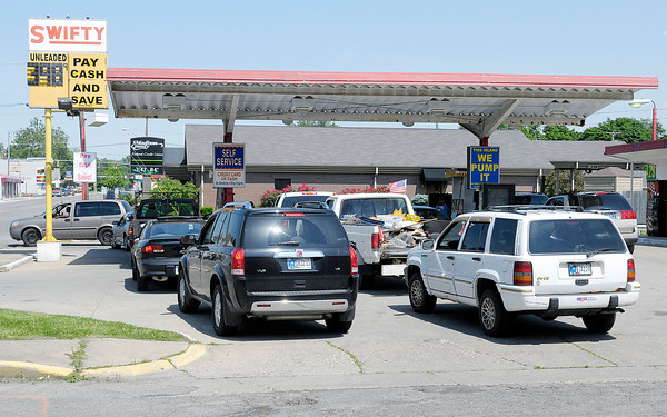 Motorists wait in line at Swifty on 8th street, one of the few stations still selling gas for $3.98 on Wednesday afternoon. Gas jumped to $4.25 at stations around town on Wednesday.