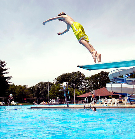 Barry Couch, 12, of Pendleton, dives into summer at Brown Pool in Pendleton Tuesday even though there was a nip in the air with below-normal temperatures.