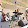 The band Better Luck Sally plays a free concert during the Regions Archery competition at Athletic Park on Friday. The Regions Archery competition continues through Sunday.