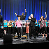 "Don Knight/The Herald Bulletin<br /> The worship team brings the crowd to their feet as they perform ""He Reigns"" during the Opening Event of the Church of God Global Gathering at the Kardatzke Wellness Center on Saturday."