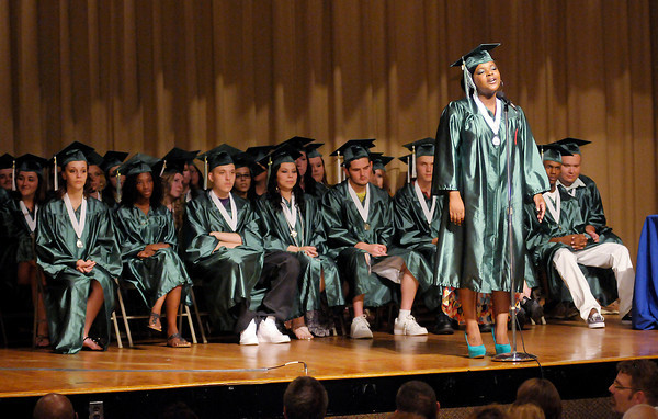 """Graduate Shaniece Turner sings """"Never Give Up"""" during The Excel Center's graduation at the City Building auditorium on Thursday."""