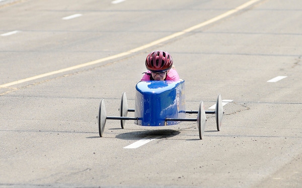 Don Knight/The Herald Bulletin<br /> Kristina Kelty, 12, races down the hill at Derby Downs during the Anderson Soap Box Derby on Saturday.