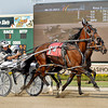 Don Eash, driving Diamonds Princess in the third race, beats out Dontgetinmychips at the finish line and the giant grandstand video board.