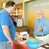 Paul Goodpaster, right, of Red Gold Transport talks to Jerry Hale about job openings during the Central Indiana Job/Career Fair at Madison Park Church of God on Thursday.