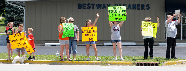 Don Knight/The Herald Bulletin<br /> Protestors stand along Scatterfield road just south of Gene's Rootbeer on Friday. APD is investigating a complaint by former employees alleging Gene's owner's took a portion of their tips.