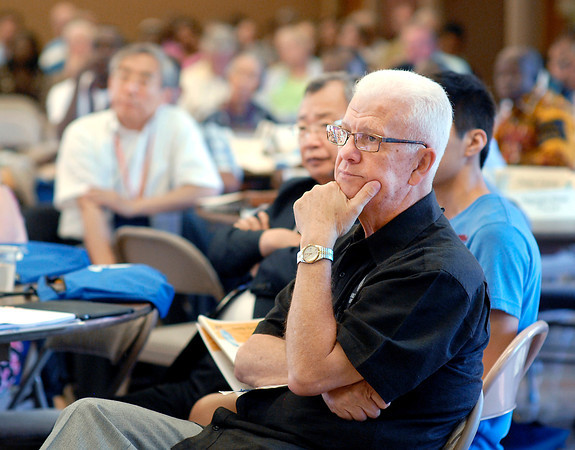 Dr. Ron Duncan, general director of Church of God Ministries, listens to the speaker Friday at one of the 2013 Global Gathering sessions.