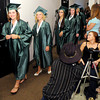 Graduates file into the City Building auditorium during The Excel Center graduation on Thursday.