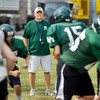 Pendleton Heights High School football coach John Broughton watches his players go through football drills Tuesday.
