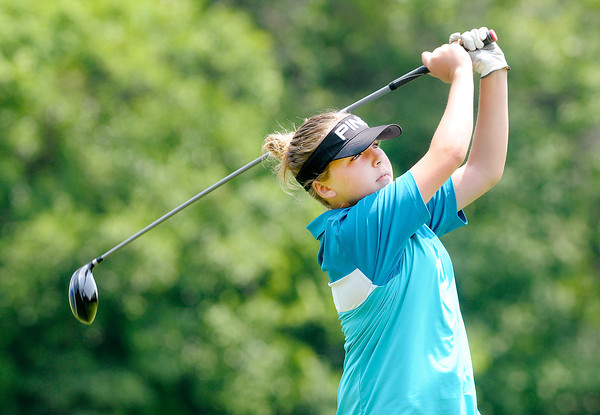 Kristen Hobbs, 12, watches her tee shot off the first tee as the Madison County Junior Tour stopped at Grandview Golf Course on Wednesday.