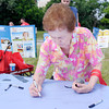 "Don Knight/The Herald Bulletin<br /> Eula Carr signs a section of the ""World's Largest Anniversary Card"" as Prairie Farms held an event at Athletic park on Saturday to celebrate their 75th Anniversary."