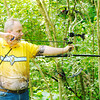 Don Knight/The Herald Bulletin<br /> Tony Girt aims at a 3D target during the Regions Archery competition at the Rangeline Nature Preserve on Saturday.