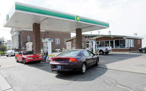 Motorists fill up at the Ricker's on 8th Street in Anderson on Wednesday. Gas prices are expected to be lower this summer.