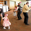 At left, Richard Harvey twirls his daughter Ivajane, 4, as Celebration Church at Arrow Heights hosted the Just D.A.D. event for dads and their daughters on Saturday at the Madison Park Church of God. Also dancing at center is Andy Stephenson and Mackenzie and Robert Scott and Lillian at right.