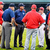 John P. Cleary   The Herald Bulletin<br /> Umpires and coaches from Wapahani and Frankton confered behind home plate as the rain continued to fall on whether to wait or postpone their 2A sectional baseball game Monday. The game will be played Tuesday afternoon at 5 p.m.