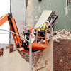 John P. Cleary | The Herald Bulletin<br /> Workers from Gerry Construction work by hand from a bucket lift to loosen and knock down debris from the third level of the building in the 700 block of Meridian Street that had a partial collapse last week. To view or buy this photo and other Herald Bulletin photos, visit<br /> photos.heraldbulletin.com.
