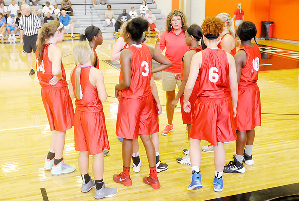 Don Knight | The Herald Bulletin<br /> Frankton's Katie Key and Anderson's Dabrionna Williams huddle with their teammates during the first game of the Indiana Class Basketball All-Star Classic at Anderson University on Friday. Seniors from across the state with play in four games scheduled for Saturday.