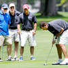 Don Knight | The Herald Bulletin<br /> Nathan McBride from Connecticut Electric putts on the ninth green as from left, Fox 59's Bob Donaldson, Kevin Atkinson and Scott Temple look on during the Children's Clinic Classic at the Anderson Country Club on Tuesday. Also representing Connecticut Electric but not pictured was Tiffany Dzerve. To view or buy this photo and other Herald Bulletin photos, visit photos.heraldbulletin.com.