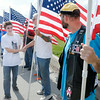Don Knight   The Herald Bulletin<br /> Travis Colvill greets Indiana Patriot Guard Riders who were waiting to escort him to his grandparent's home on Saturday. Travis' father, Robert Colvill Jr., was killed in Iraq 10 years ago.