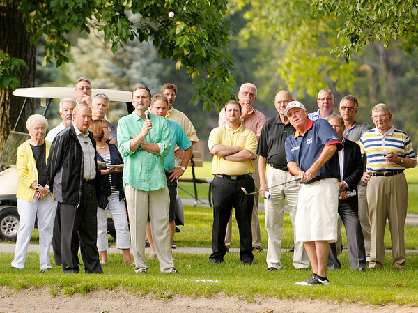 Don Knight | The Herald Bulletin<br /> Mark Calcavecchia gives pointers during a clinic that was part of the Children's Clinic Benefit and Pairings Party at the Anderson Country Club on Monday.