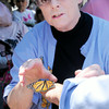 Don Knight | The Herald Bulletin<br /> Kathy Ogle places a monarch butterfly on Mayor Kevin Smith's hand as Harter House celebrated their new Monarch butterfly way station with a butterfly release and ribbon cutting on Thursday. To view or buy this photo and other Herald Bulletin photos, visit photos.heraldbulletin.com.