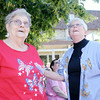 Don Knight | The Herald Bulletin<br /> From left, Patsy Mahorny and Kathy Cole watch a monarch butterfly fly away as Harter House celebrated their new monarch butterfly way station with a butterfly release and ribbon cutting on Thursday.  To view or buy this photo and other Herald Bulletin photos, visit photos.heraldbulletin.com.