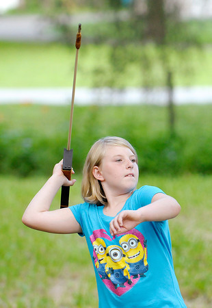 Don Knight   The Herald Bulletin<br /> Raelynn Pease of Middletown, 10, takes aim with an atlatl, a prehistoric hunting tool, as Mounds State Park marked the beginning of Summer with a Summer Solstice Celebration on Saturday.