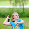 Don Knight | The Herald Bulletin<br /> Raelynn Pease of Middletown, 10, takes aim with an atlatl, a prehistoric hunting tool, as Mounds State Park marked the beginning of Summer with a Summer Solstice Celebration on Saturday.