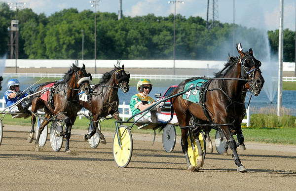 Don Knight | The Herald Bulletin<br /> Trace Tetrick drives JL Don't Wast my Time (4) to a win in the fifth race at Hoosier Park on Saturday. To view or buy this photo and other Herald Bulletin photos, visit photos.heraldbulletin.com.