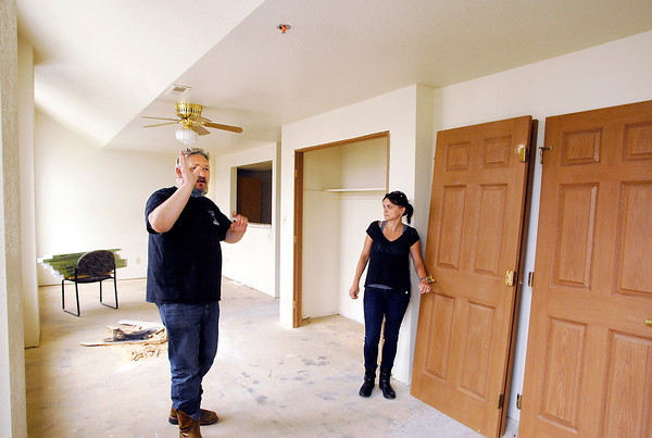 John P. Cleary | The Herald Bulletin<br /> Youri and Olga Frakine, owners of the Tower Apartment building, go through one of the apartments as they continue to rehab the building.