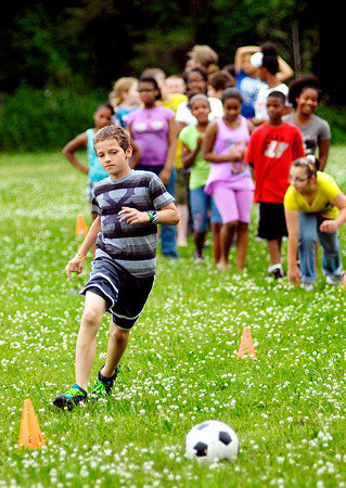 John P. Cleary   The Herald Bulletin<br /> Kids ran through cones around a course during the first day of Anderson Parks Department's Summer Camp last week. The camp runs Monday-Friday through July 31st from 9 a.m. to 4 p.m. held at the Geater Community Center.