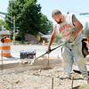 Don Knight | The Herald Bulletin<br /> Partners-N-Concrete prepare forms for new sidewalks on University Boulevard on Tuesday. Sidewalks are being replaced at the intersections and will include ramps. Anyone working outside faced temperatures near 90 with high humidity on Tuesday, and today's forecast is calling for more heat.