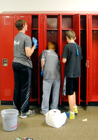 """John P. Cleary   The Herald Bulletin<br /> Teens from four church youth groups participated in """"Project 765"""", a three-day event of activities and community service work throughout Anderson. One of the locations of their volunteer efforts was Anderson High School where students washed out the lockers. To view or buy this photo and other Herald Bulletin photos, visit<br /> photos.heraldbulletin.com."""