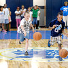 John P. Cleary | The Herald Bulletin<br /> Travis Fisher, 8, and Brelan Holloway, 8, race down the court dribbling a basketball as they compete in a relay race during the first day of the Anderson Parks Department's Summer Camp held at the Geater Community Center.  The camp runs Monday-Friday through July 31st from 9 a.m. to 4 p.m.  To view or buy this photo and other Herald Bulletin photos, visit<br /> photos.heraldbulletin.com.