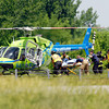 John P. Cleary | The Herald Bulletin<br /> Fire-rescue personnel load up one of the two air ambulances that were called to the scene of a two vehicle accident in the northbound lanes of Interstate 69 Tuesday morning near exit 234 that killed one and injured six other persons<br /> .
