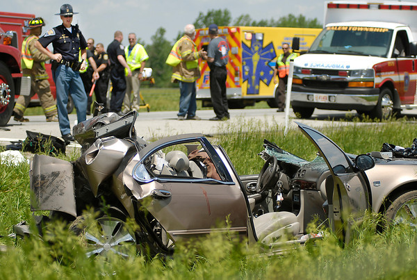 John P. Cleary | The Herald Bulletin<br /> This State Trooper looks over the scene of a two vehicle accident in the northbound lanes of Interstate 69 Tuesday morning near exit 234 that killed one and injured six other persons.