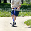 John P. Cleary | The Herald Bulletin<br /> Clayton Smith, 12, rides his scooter down the hill in Pulaski Park Tuesday afternoon as he and his family were out enjoying a day in the park since school is out for the summer.