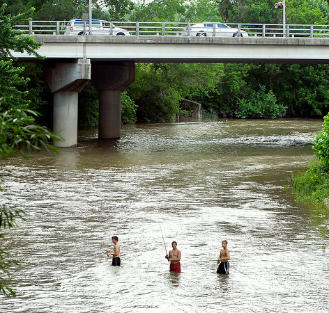 John P. Cleary | The Herald Bulletin<br /> These three fellows found a good way to cool off and do some fishing at the same time as they waded out to the middle of White River down from the Truman Bridge in Anderson Wednesday afternoon to cast their lines.