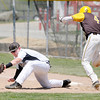 Don Knight | The Herald Bulletin<br /> Daleville's Levi Floyd forces Monroe Central's Beau Combs out at first during the sectional semi-final at Daleville on Saturday. To view or buy this photo and other Herald Bulletin photos, visit photos.heraldbulletin.com.