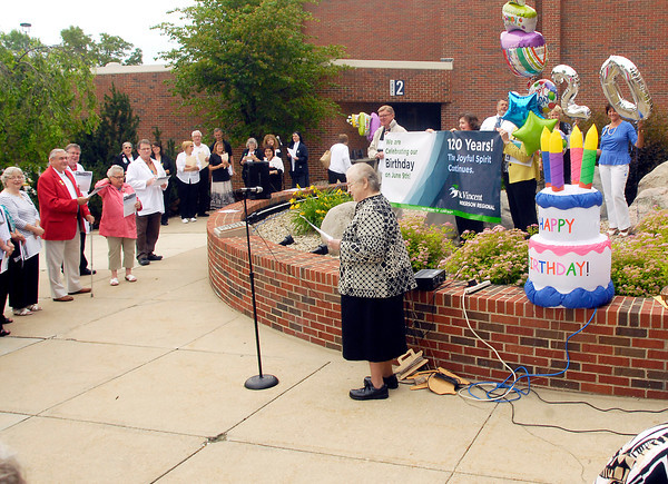 John P. Cleary   The Herald Bulletin<br /> Sister Kathleen Reilly leads those gathered Monday morning in singing Happy Birthday to us as St. Vincent Anderson Regional Hospital celebrated their 120th birthday.