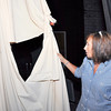 Stu Hirsch | The Herald Bulletin<br /> Anderson High School secretary Laura Crenshaw holds a stage curtain that is one of many items that need to be replaced at the school after 50 years of service.