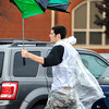 John P. Cleary | The Herald Bulletin<br /> This baseball fan still tried to use his umbrella after it was busted by gusty winds and rain while leaving the Frankton 2A sectional baseball game Monday at Frankton after it was postponed until Tuesday due to the rains.