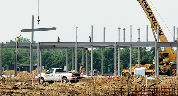 John P. Cleary | The Herald Bulletin<br /> The new Anderson Ivy Tech Community College building on East 60th Street is starting to take shape as workers have started hanging steel this week.
