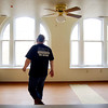 John P. Cleary | The Herald Bulletin<br /> Youri Frakine, owner of the Tower Apartment building, go through one of the apartments as they continue to rehab the building.