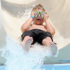 Don Knight | The Herald Bulletin<br /> Dillon Stanley, 8, holds onto his goggles as he splashes into the pool at Alexandria on Thursday. Admission to the pool is $4 per person or $30 for a individual season pass.