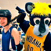 John P. Cleary | The Herald Bulletin<br /> Pacers mascot Boomer plays with Shanntelle Castle's pony tail during the Community Safety Fair at Mounds Mall Wednesday. Castle, 13,  is a member of the Hoosier Bruisers Jr. Roller Derby team at the event recruiting new members for their sport.