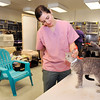 John P. Cleary | The Herald Bulletin<br /> Lexi Dollens, a volunteer tech assistant at the Animal Protection League, stops  to give Candy some attention while she was in the cat room at the shelter. The shelter is going cageless with the cats in the cat room so they can roam, play, and socialize.