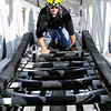 Mark Maynard | For The Herald Bulletin<br /> Alexandria Fire Department recruit Jake Hendrick climbs the Elwood Fire Department's 100 foot snorkle truck ladder during testing recently.